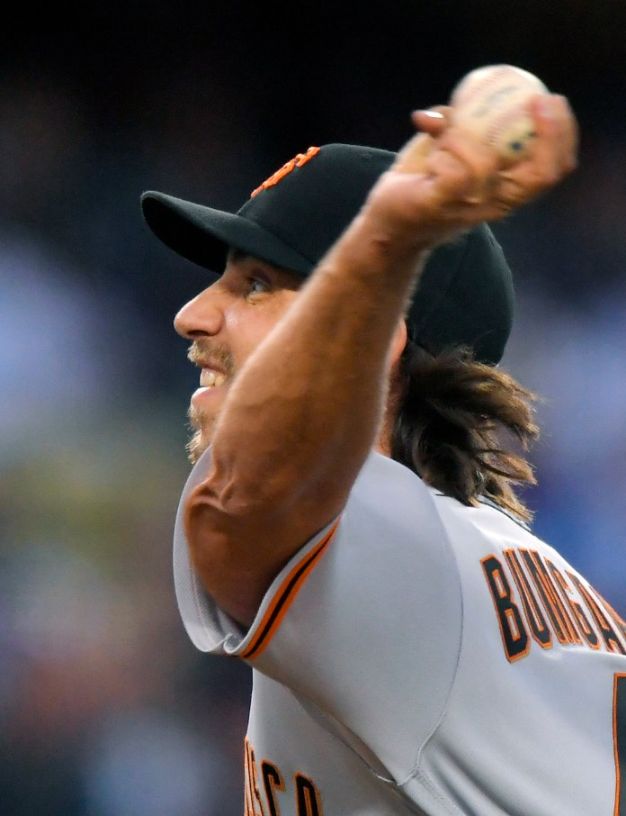 San Francisco Giants starting pitcher Madison Bumgarner throws during the second inning of a baseball game against the Los Angeles Dodgers, Saturday, Sept. 23, 2017, in Los Angeles. (AP Photo/Mark J. Terrill)