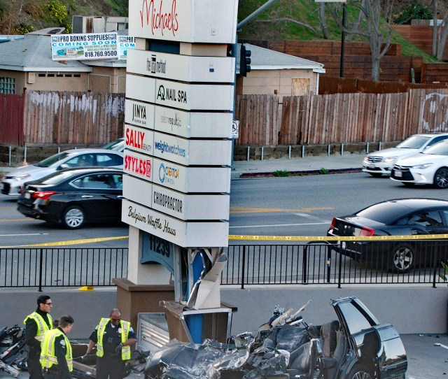 Investigators Surround A Destroyed Range Rover After The Vehicle Which Was Traveling West On Ventura Boulevard Early Wednesday Morning Left The Roadway