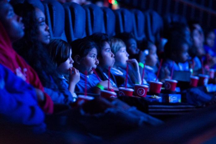Kids from Boys & Girls Club watch the Black Panther movie at a special Boys & Girls Club IMAX screening in Long Beach Thursday, February 15, 2018. As part of the viral #BlackPantherChallenge campaign, IMAX, Regal Entertainment Group, Walt Disney Pictures and Marvel Studios, hosted an advance IMAX screening of Black Panther for the Boys & Girls Club Long Beach. Club members got to see the film before its nationwide release. (Photo by Thomas R. Cordova / Daily Breeze) nationwide release. (Photo by Thomas R. Cordova / Daily Breeze)