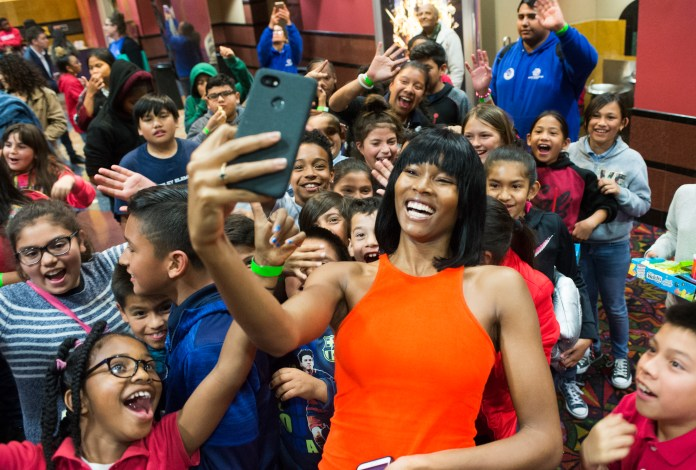 Damaris Lewis does a selfie with kids after watching the movie Black Panther as the Boys & Girls Club members got to watch the Black Panther movie at a special Boys & Girls Club IMAX screening in Long Beach Thursday, February 15, 2018. As part of the viral #BlackPantherChallenge campaign, IMAX, Regal Entertainment Group, Walt Disney Pictures and Marvel Studios, hosted an advance IMAX screening of Black Panther for the Boys & Girls Club Long Beach. Club members got to see the film before its nationwide release. (Photo by Thomas R. Cordova / Daily Breeze)