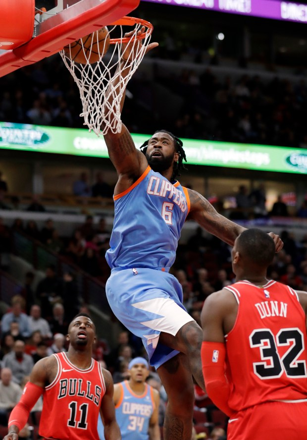 Los Angeles Clippers center DeAndre Jordan (6) dunks against the Chicago Bulls during the first half of an NBA basketball game, Tuesday, March 13, 2018, in Chicago. (AP Photo/Nam Y. Huh)