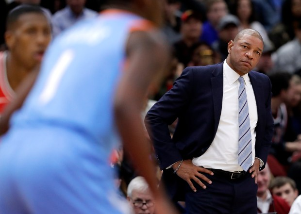 Los Angeles Clippers head coach Doc Rivers watches his team during the second half of an NBA basketball game against the Chicago Bulls, Tuesday, March 13, 2018, in Chicago. The Clippers won 112-106. (AP Photo/Nam Y. Huh)
