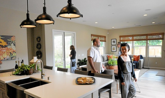 Home Shoppers Take In A Model Home Open House In The New Development Of Stoney Point Estates Located Across From Stoney Point Park On Topanga Canyon