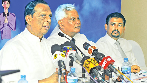 Minister John Amaratunge, Sri Lanka Tourism Chairman Paddy Withana and  Director General Malraj Kiriella. Picture by Samantha Weerasiri