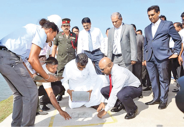 Megapolis and Western Development Minister Patali Champika Ranawaka,Waters Edge  Chairman, Chamath De Silva and General Manager, Rohan  Fernandopulle and UDA officials at the groundbreaking ceremony.
