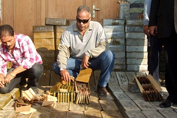 Security forces display some of the ammunition seized in the Suez governorate. (DNE / Hassan Ghonema)