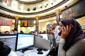 Dealers are seen at the Egyptian stock exchange market in Cairo. Only seven stocks rose, 156 fell and nine remained unchanged Photo by Mohamed Omar