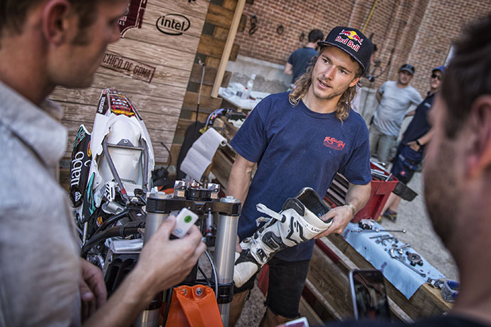 A technician works with athletes and engineers to add an Intel Curie sensor before the start of the Red Bull X-Fighters event. (Credit: Sebastian Marko/Limex Images/Intel Corporation)
