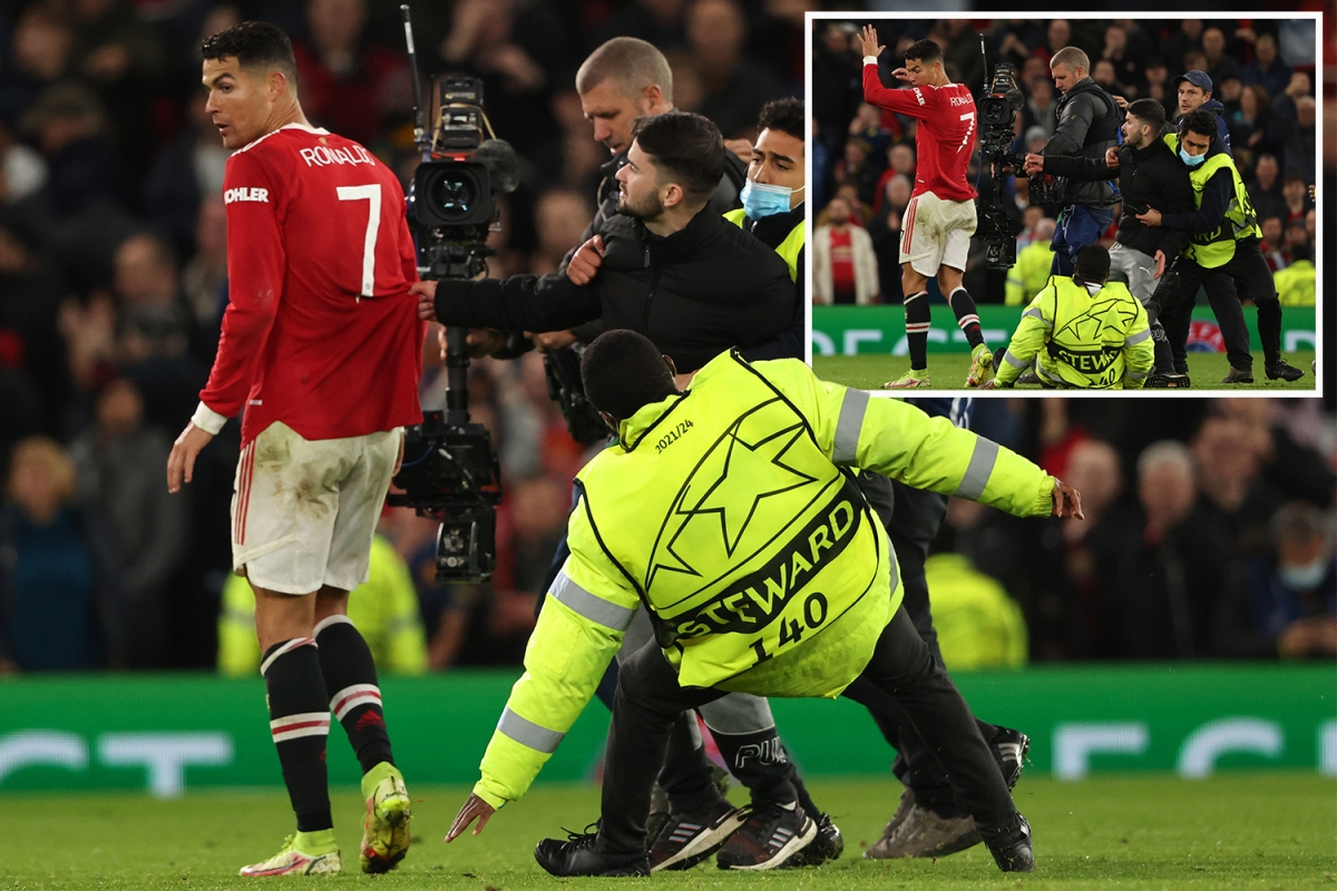 Watch Man Utd stewards catch pitch invader INCHES from shocked Cristiano Ronaldo after chasing fan whole length of field