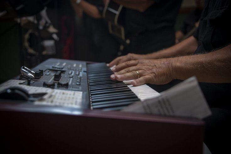 Old Man Playing Piano