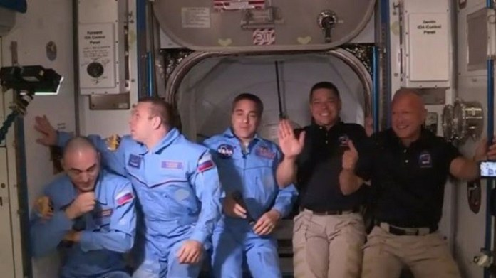 History made as capsule docks with space station২