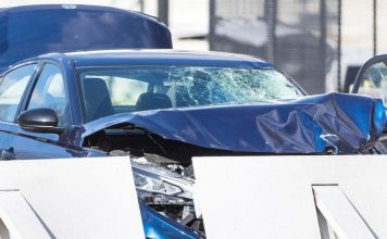 Police officer dies after car rams security barrier
