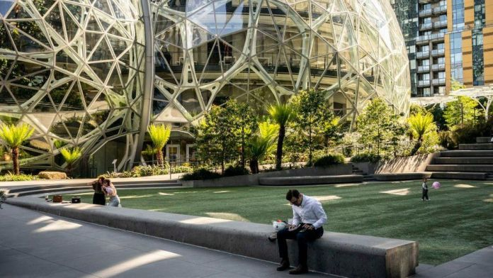 Amazon delays office return until 2022 as Covid spreads