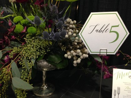 Daisy Designs' green hexagon table number at LGBTQ+ wedding show