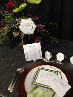 Daisy Designs' green hexagon stationery at LGBTQ+ wedding show