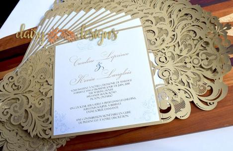 Gold Laser Cut invites displayed in a fan shape