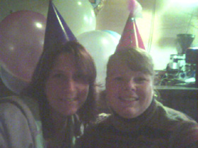 lisa and gwen at gno wearing party hats