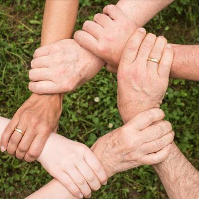 crossed hands united