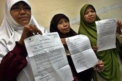 Tiga perawat berjilbab (inilah.com /Wirasatria)