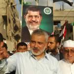Perdana Menteri Palestina Ismail Haniyah bergabung dalam perayaan kemenangan Muhammad Mursi di kota Gaza, Palestina (24/6). (Getty Images)