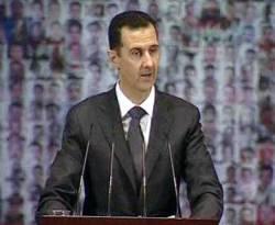 Presiden Suriah Bashar al-Assad berbicara di Opera House di Damaskus. (yahoo.com)