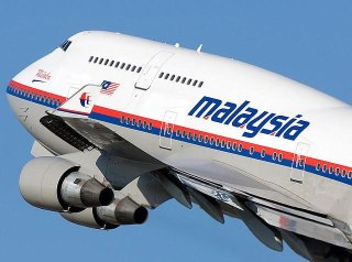 Boeing 777-200 Malaysia Airlines (MAS), - Foto: pakistantribe.com