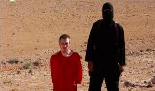 Peter Kassig dan personil ISIS (aljazeera)