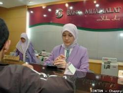 Transaksi di sebuah Bank Syariah (kontan.co.id)