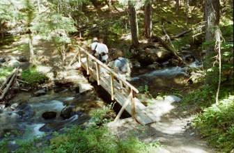 Laura's lovely art shot of moving water and moving people, Sprague Creek