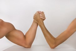 http://www.dreamstime.com/royalty-free-stock-photo-two-hands-clasped-arm-wrestling-strong-weak-unequal-match-man-s-image44697815