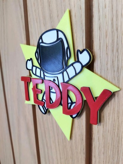 Astronaut star door sign in yellow and red