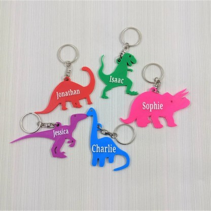 Dinosaur themed keyrings in different designs and colours