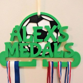 Football themed medal holder in green