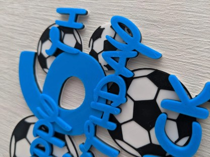 football themed birthday cake topper in blue