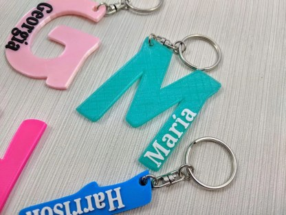 Keyrings with name and initial letter in various colours