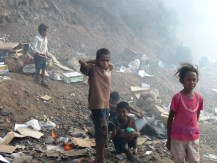 Children search for useful items at Dili's garbage dump.