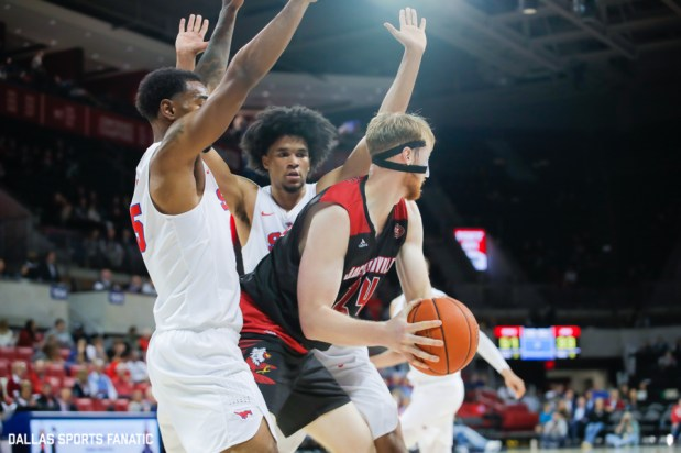 Jacksonville State forward Martin Roub is swarmed by SMU players during the game between SMU and Jacksonville State on November 5, 2019 at Moody Coliseum in Dallas, Tx. (Photo by Joseph Barringhaus/Dallas Sports Fanatics)