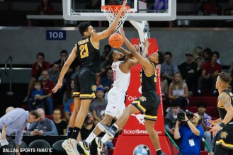 Players collide in front of the net during the American Athletic Conference college basketball game between the SMU Mustangs and the Wichita State Shockers on March 1, 2020 at Moody Coliseum in Dallas, Texas. (Photo by Joseph Barringhaus/Dallas Sports Fanatic)