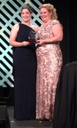 Shelley Stracener receiving her award from SWE President Colleen Layman