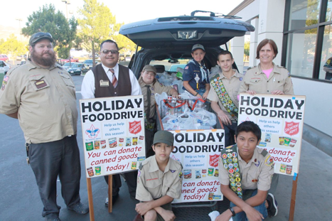 Collecting food for the hungry: Back row left to right Scout Leader Charles Price, Stater Bros. Manager Jorge Moreno, Stone Price, Austin Price, Lucus Compagna, Scout Leader Anne Compagna. Front left William Anderson, and front right Jason Bun.
