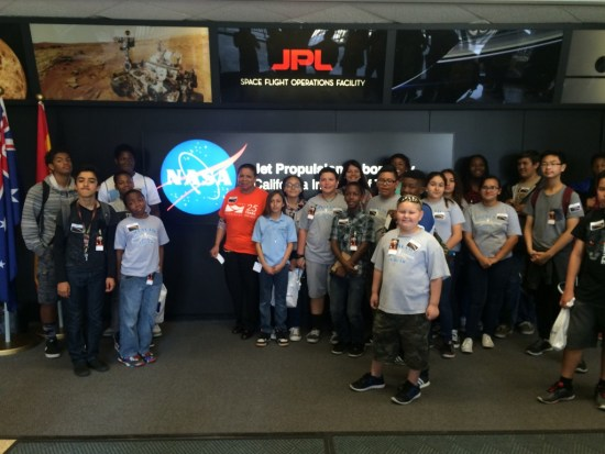 Deborah Robertson with NASA Astronaut class of 2040 (Rialto students) in front of the Space Flight Operations Facility control room. Photo by: Jazminn Diaz