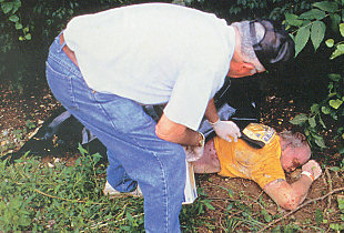 Dr. Bass examining a cadaver after a brief stay out-of-doors