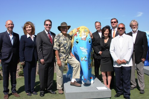 "Local leaders are joined by co-founder of the Elephant Parade, Mike Spits (left) and the parade's U.S. ambassador, Dana Yarger (right), at a welcoming of the herd event at the St. Regis Monarch Beach Resort. The elephant pictured is entitled ""Zia Skye"" by Laura Inkster. Photo by Andrea Swayne"