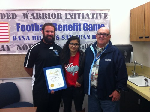 Eneida Bustos, a junior at Dana Hills and president of the school's Save Or Students Club, was honored by Assemblywoman Diane Harkey for her community service and leadership. Pictured (L to R) Todd Rusinkovich, Eneida Bustos and Mike Darnold. Courtesy photo