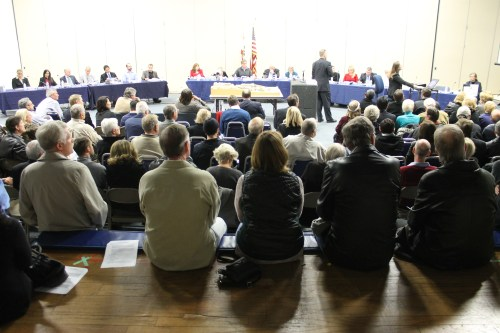 Nearly 100 people pack the Dana Point Community Center gym Monday for the Planning Commission's public hearing on the Doheny Hotel proposal. After dozens spoke in opposition and the developer, Beverly Hills Hospitality Group, presented an alternative plan, the Commission continued the hearing until its February 10 meeting. Photo by Andrea Papagianis