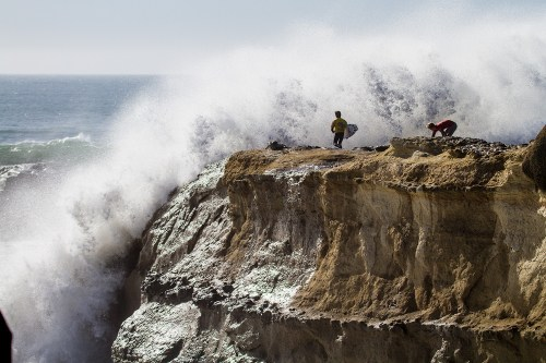 Competitors in the Surfing America Prime at Steamer Lane had to more carefully time their jump into the lineup from the cliff at the point on January 12, day two of the event, due to huge surf. Photo by Jack McDaniel