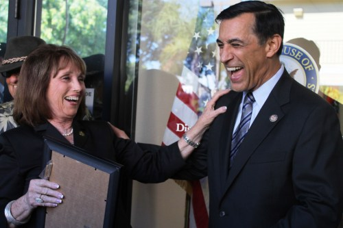 Orange County Supervisor Pat Bates (right) and Rep. Darrell Issa share a laugh during the opening of Issa's Dana Point office. Photo by Andrea Papagianis