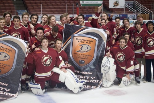 The Capistrano Coyotes ice hockey team celebrates on the ice at the Honda Center after winning the Anaheim Ducks High School Hockey League's Varsity 2A Division Championship. Photo by Leslie Bird