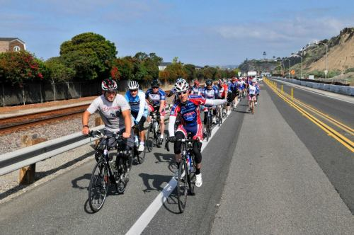 Accompanied by more than 50 cyclists, wounded veteran Rob Jones rides down Pacific Coast Highway en route to the final stop of his cross-country trip, Camp Pendleton. Photo: Tiffini Skuce Ride 2 Recovery