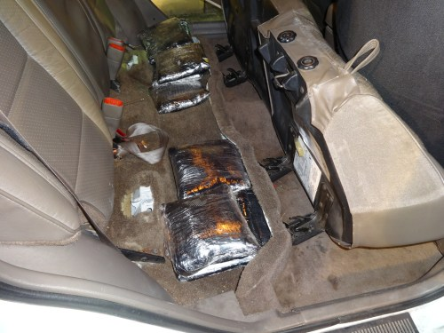 U.S. Border Patrol agents observed 10 cellophane wrapped bundles of methamphetamine under the rear seat of an SUV during a stop Thursday. Photo: Courtesy